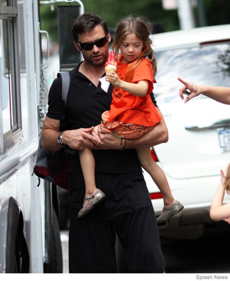 Best Celebrity Dad Photos - 12 Famous Dads with Their Kids
