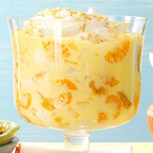 Pineapple Orange Trifle - pineapple, milk, instant vanilla pudding, sour cream, mandarin oranges, angel food cake, whipped cream, orange extract, coconut.