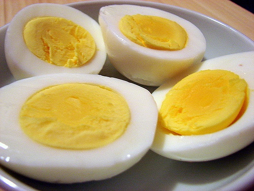 Ina Garten's secret to perfect hard boiled eggs every single time! No overcooked yolks with green on them. Put Cold water and cold eggs in a pot. burners on on high heat, watch carefully, as soon as it gets to a rolling boil, turn off the burner, cover and let sit for 5 minutes. Take eggs out of water and let sit for another 2 minutes. Then immediately either peel them or shock them in cold water. It's best to use eggs about a week old so they peel easier.