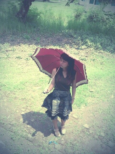 With an umbrella in the cloudy scene..