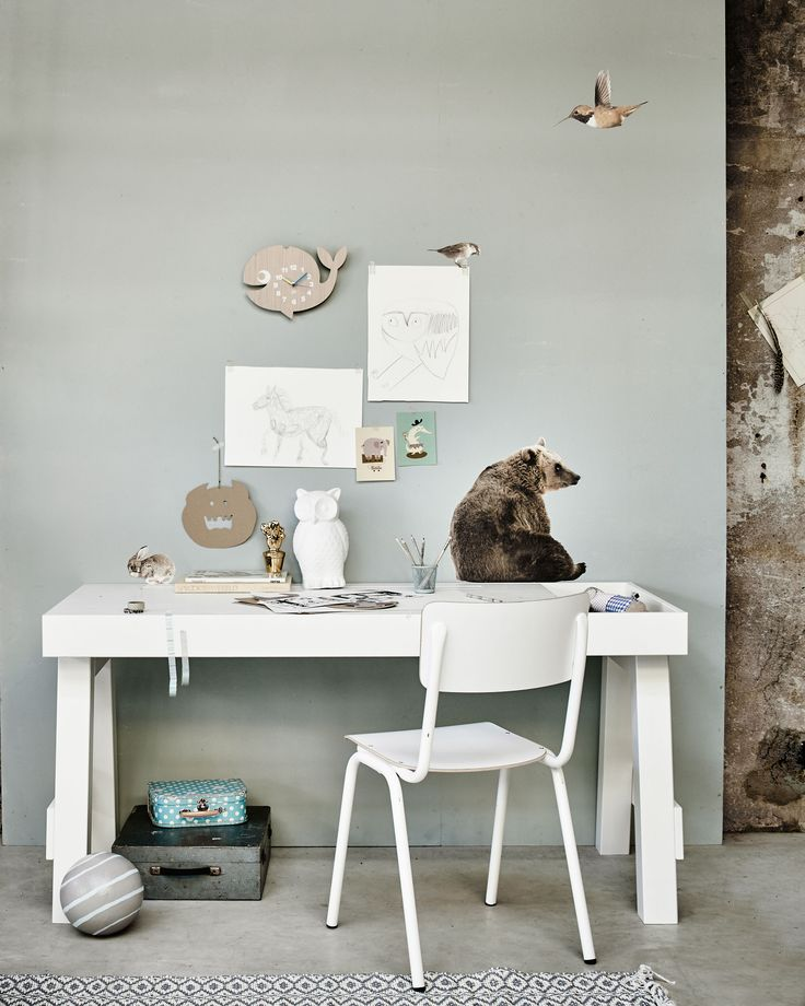 Bright workspace in an industrial building, with a white desk, white chair, wallstickers of a bear, a bird and a rabbit, and an owl lamp   Styling Fietje Bruijn, Marianne Luning, Frans Uyterlinde   vtwonen june 2015   #vtwonenshop