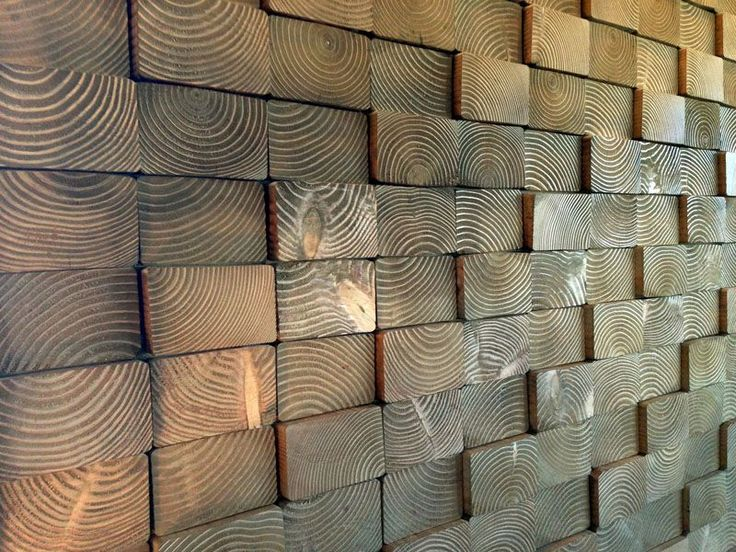 DIY this wall treatment by simply applying cut end pieces of 4×6 or 4×8′s to sheets of plywood with construction adhesive, then applying the...
