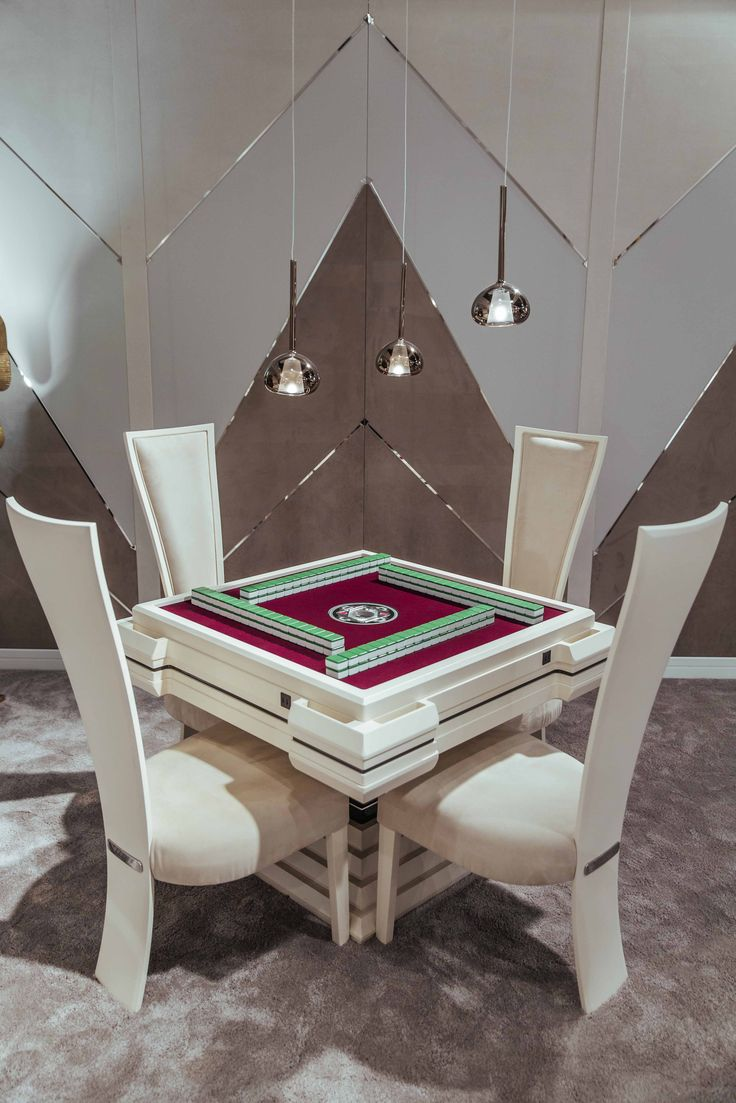 Vismara Design Mahjong Table, an automatic game table with a clever hidden mechanism that sorts automatically the playing tiles. Everything is surrounded by exclusive wall panels made of leather and lacquered wood.