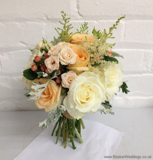 Wedding Flowers Liverpool, Merseyside, Bridal Florist, Booker Flowers and Gifts, Booker Weddings  Peaches & Cream Wild Country Garden Bridal Bouquet with roses, spray roses, astilbe, hypernicum berries & grey senicio leaves Side View
