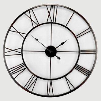 Horloge murale ronde en métal noir ajouré 80cm