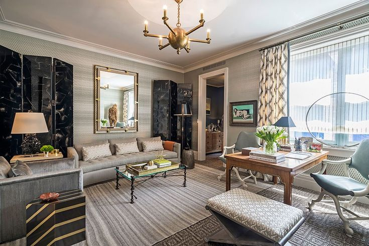 Silvery tones join touches of golden metal in Thom Filicia's study. Though the soothing room is resolutely neutral, patterns and textures enrich and enliven, from the basket-weave carpeting to the diamond-motif curtain fabric to the hypnotic material stretched across the walls. thomfilicia.com