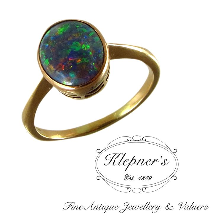 15ct yellow gold Vintage ring, rub set with a 1.20ct black solid opal, featuring a tapered band. Visit us at www.klepners.com.au