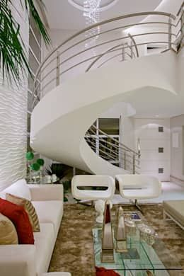 Salas / recibidores de estilo moderno por Designer de Interiores e Paisagista Iara Kílaris