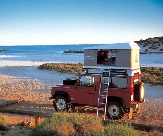 I no longer need a man with a van, I need a man with one of these! Land Rover Defender + tent