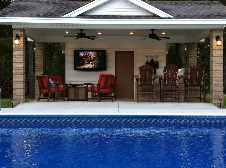 Our pool house. Outdoor grill, fridge under the concrete counter, bathroom, fire pit coffee table and flatscreen. Ahhhhh Just perfect!!! My favorite room in my house!!