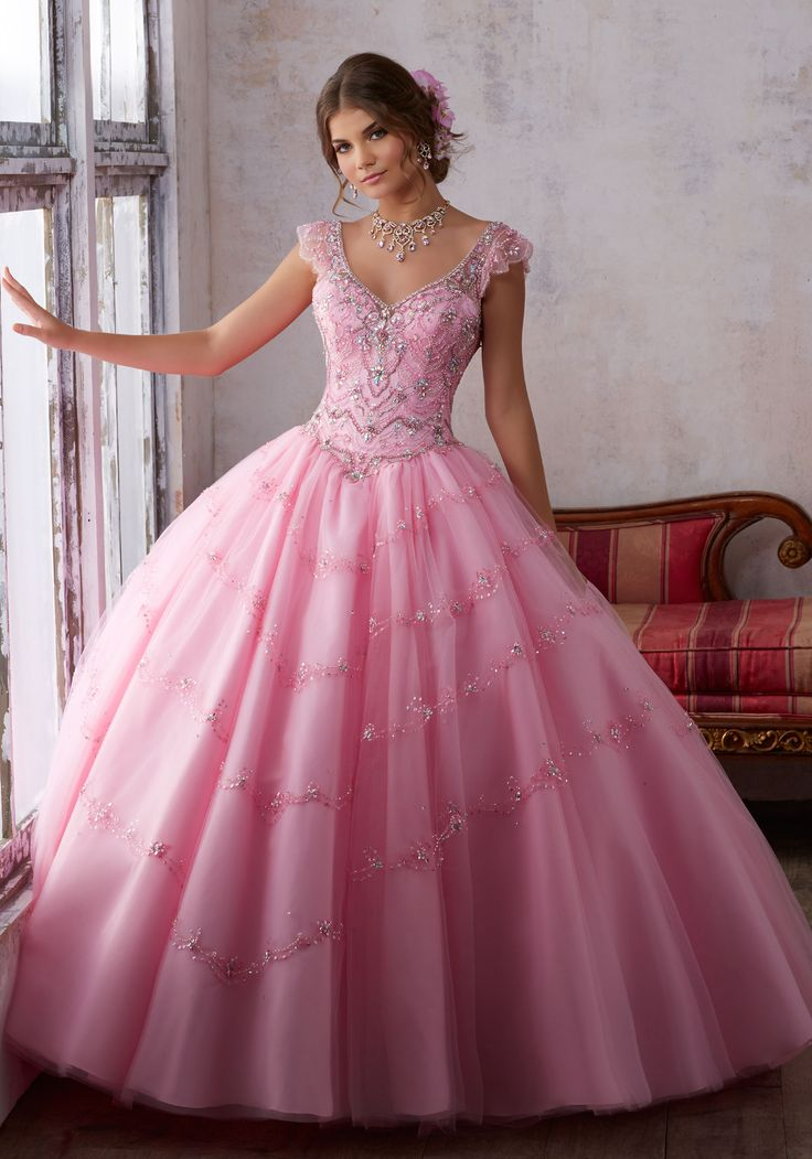 Jeweled Beading on a Tulle Ballgown | Vizcaya Style 89136 | Fit for a Fairytale, This Tulle Quinceañera Ballgown Features a Beaded Bodice with Flutter Cap Sleeves. The Skirt is Beaded to Create a Tiered Look. Matching Stole