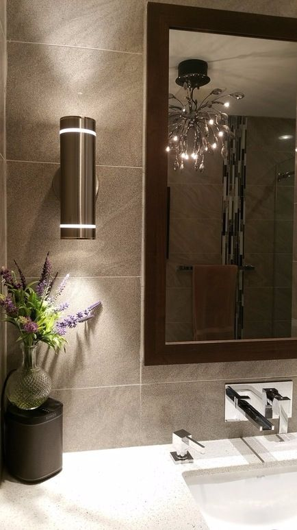 Take your bathroom to another level with ceramic tiled walls and dark cabinets. Beautiful light fixtures will add even more style to the space! Jazz up your bathroom with more design ideas with SCD Design & Construction!