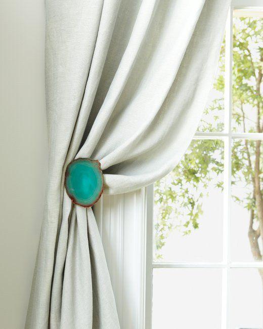 DIY decorative curtain tiebacks. Use any embellishment like agate coasters, decorative tile, or any other flat-ish item glued to standard tieback hardware.