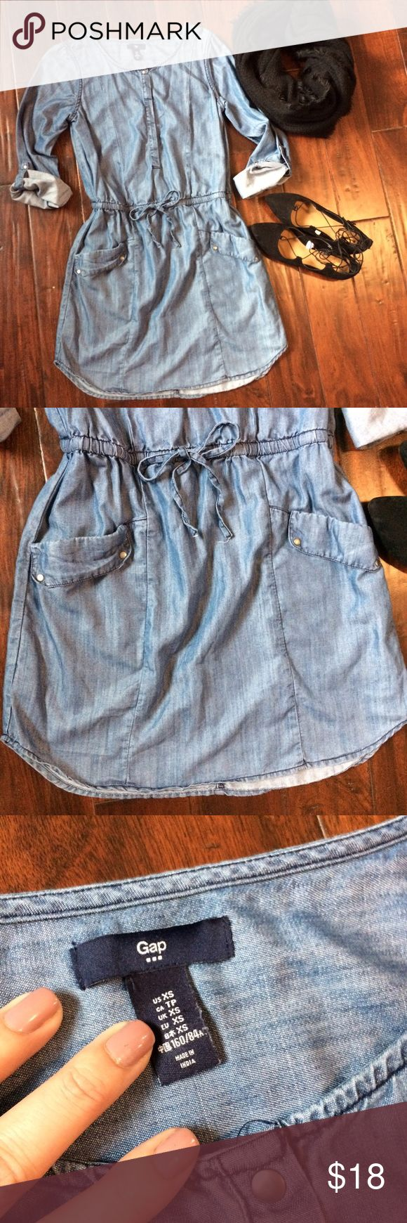 👩🏻Gap chambray denim dress xs vguc Adorable dress! Cinched waist accentuates your curves also has drawn string. Adjustable sleeves. Hidden buttons up chest with one visible metal button at top. Great spring-winter dress. Can be styled so many ways! Approx measurements taken lying flat:Length in middle from top to bottom 35inches • top to side hem 32.5•pit to pit 18 • waist 15inches GAP Dresses