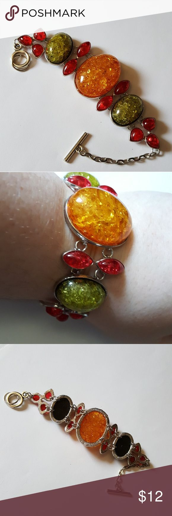 Unique Amber Bracelet This is a unique and pretty vintage style Amber Bracelet. Brand new. Silvertone. Fits up to 7 1/2 inch wrist Vintage Jewelry Bracelets
