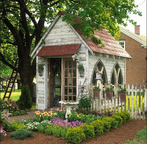 The ultimate garden shed with vintage repurposed windows and door