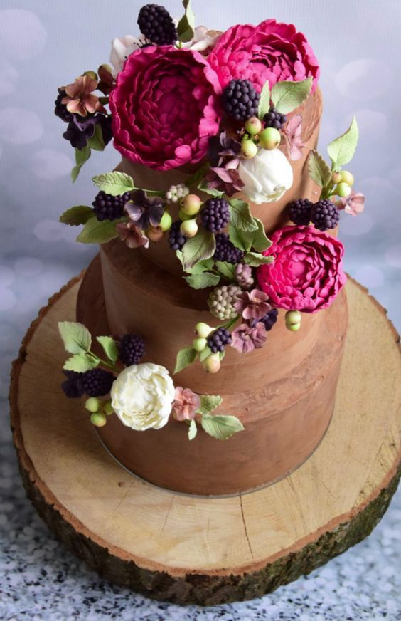 Pretty berry topped chocolate brown wedding cake; Featured Cake: Baking Chick