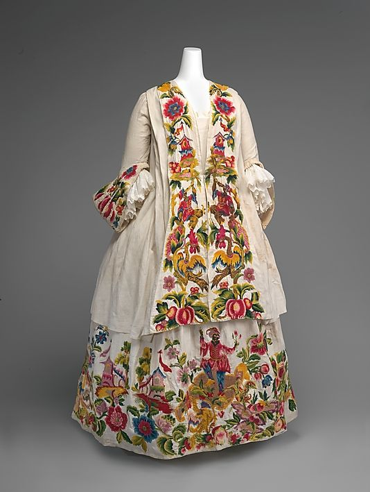 1725-1740 Jacket (Casaquin) and Petticoat. Crewel work on linen. The exotic figures represent the Four Continents amid exuberant flowers, fruits, and birds. Among the architectural elements are small pagodas, which came to symbolize the Far East in the European decorative arts. Via The Met.