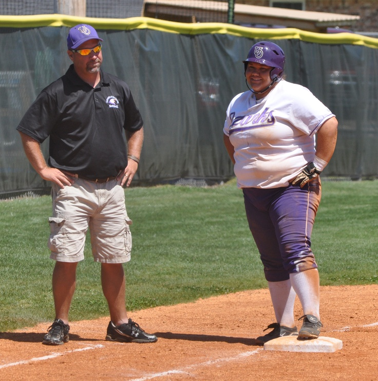 Senior Kelsey Stephens and assistant coach Monty Littlefield converse on third during the Lady Eagles' Senior Day Game