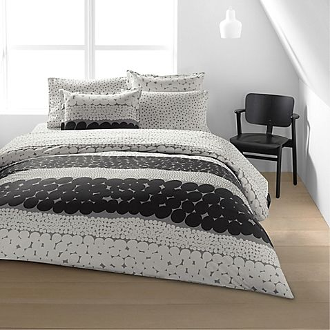 Create an ambiance of modern edge with the Marimekko Jurmo Duvet Cover Set. Dressed in circular panels of charcoal, white and grey tones, this contemporary bedding adds the perfect dose of whimsical to compliment any room's décor.