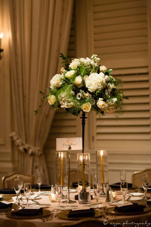 Classic, elegant ballroom centerpiece. Tall centerpiece. Wedding flowers in ivory, white, pinks and emerald greens. Anemones, hydrangeas, fern with gold accents.   Floral Design: www.papertini.com  Photographer: www.asyaphotography.com