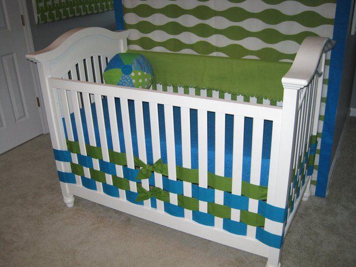 Weaving ribbon through crib rails instead of using a crib skirt. Smart.