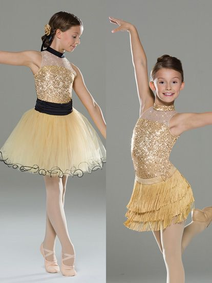 NEW! 2017 Collection All-In-One Costumes: Sequin spandex leotard with extended bike-shorts leg line has a keyhole back detail and mesh yoke with foil dots. All-In-One design includes spandex jazz skirt with fringe and attached faux buckle. Ballet skirt is layers of tulle on an elastic spandex waistband with the top layers featuring a soft swirling hem.  Includes two headpieces, bobby pins, two interchangeable collars, hanger and garment bag.