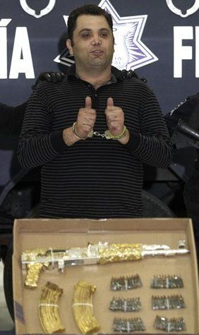 Mexico - This photo of Ramiro Pozos Gonzalez, a drug cartel leader, posing defiantly with his gold-plated AK-47, poignantly illustrates the violence of the drug trade and the resistance towards Mexican efforts to stymie such violence.