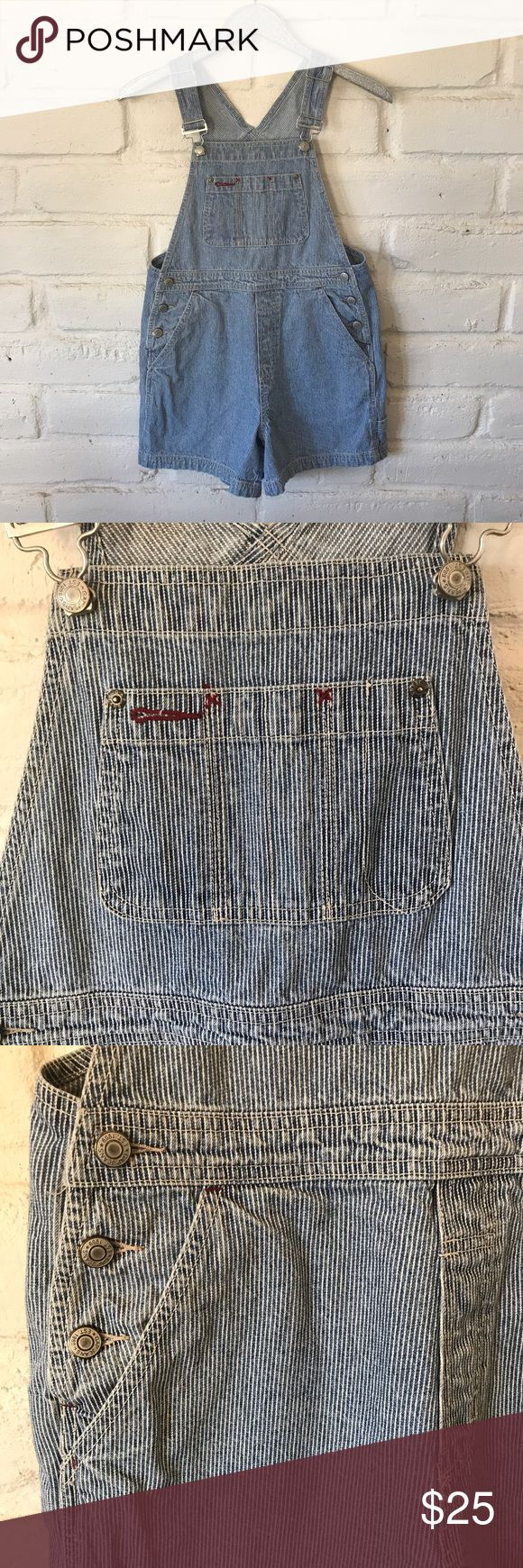 90's Vintage GAP Railroad Tracks Striped Overalls Adorable overalls, straight from the 90's! Excellent preowned condition. Light blue denim with thin white lines. Red stitched accents on the bib and back pockets. Tag says xs but these would comfortable fit up to a women's size 4. Look adorable rolled up once or twice. Adjustable straps make these perfect for long or short torsos, and everything in between! Waist measures 17 inches laid flat. Inseam measures 4 3/4 inches. Silver hardware…