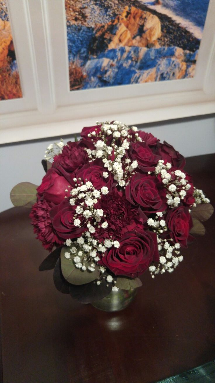 Black Baccara roses, burgundy carnations with smoke bush ...