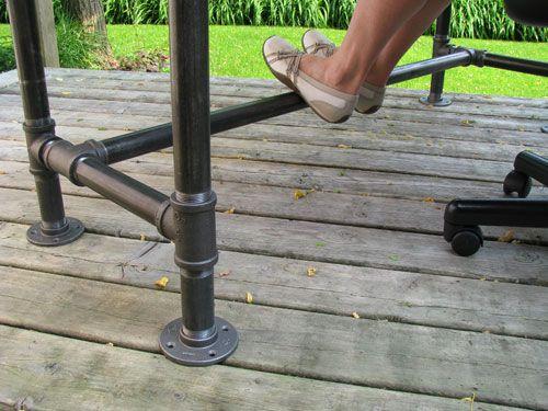 Comfortable foot-rest on pipe frame desk.  Custom pipe-frame tables and desks at www.wesleyellen.ca