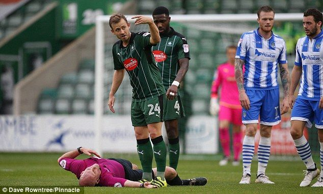 Referee Kevin Johnson taken to hospital during Plymouth's 2-1 win over Colchester