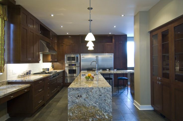 L shaped island ice brown granite countertop pendant lights brown cabinet stainless steel appliances of Installing Ice Brown Granite Countertop for Your Home Design