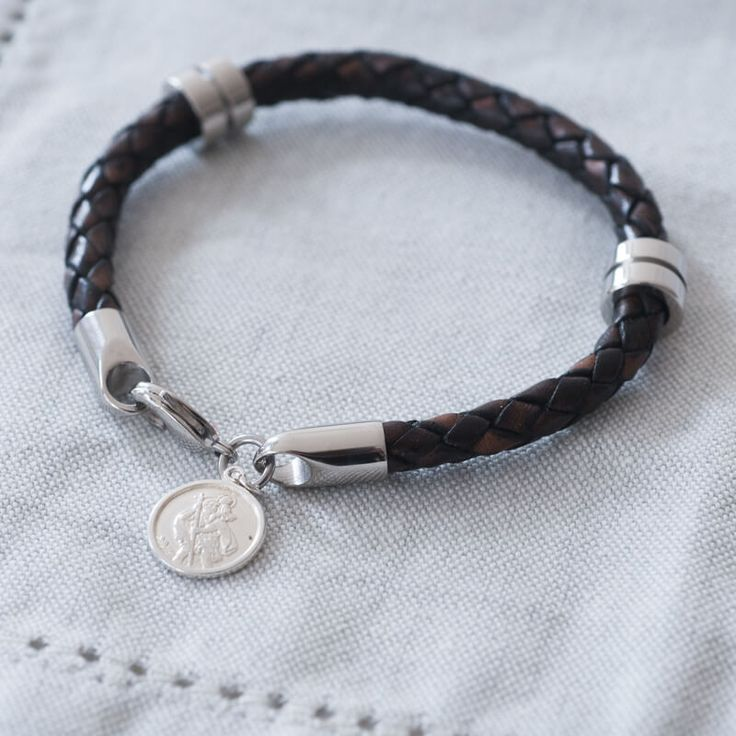 Personalised St Christopher Wristband With personalised gift box. This finely worked sterling silver St Christopher pendant hangs from a leather and stainless steel wristband. St Christopher being the patron saint of travellers, makes a t http://www.MightGet.com/january-2017-13/personalised-st-christopher-wristband.asp