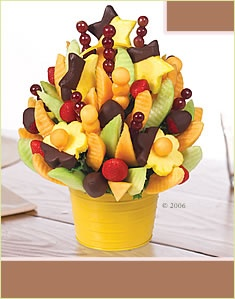 Edible Arrangements...fruit dipped in chocolate & delivered to your door...oh wait...THEIR door...yes, it's a GIFT, LOL.