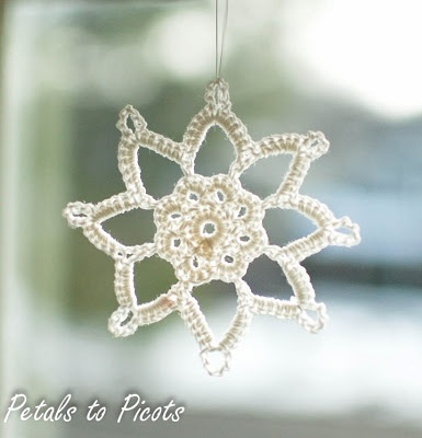 Snowflake Pattern:  Free crochet pattern for this snowflake.  Intermediate level, but if you ask me, it doesn't look very tough at all.  Should be a quickie.