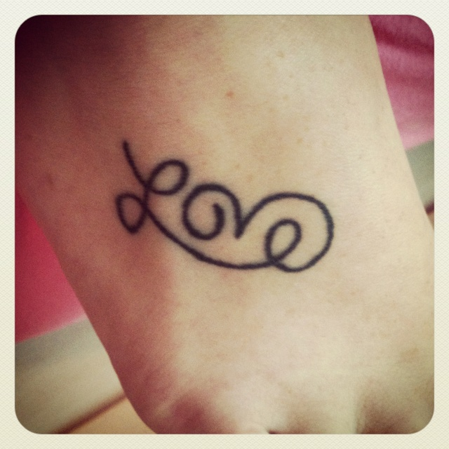 My first tattoo. Just a reminder to love with every step