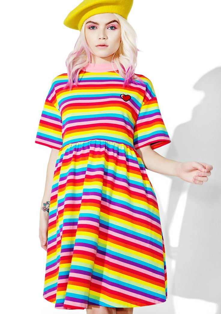 Lazy Oaf Rainbow Sally Sack Dress cuz yew get da sun shinin' after da rain, babe. Chase the clouds away in this dress that features a colorful rainbow stripe construction, short sleeves, a loose N' comfy fit, and a lil red heart on yer chest.