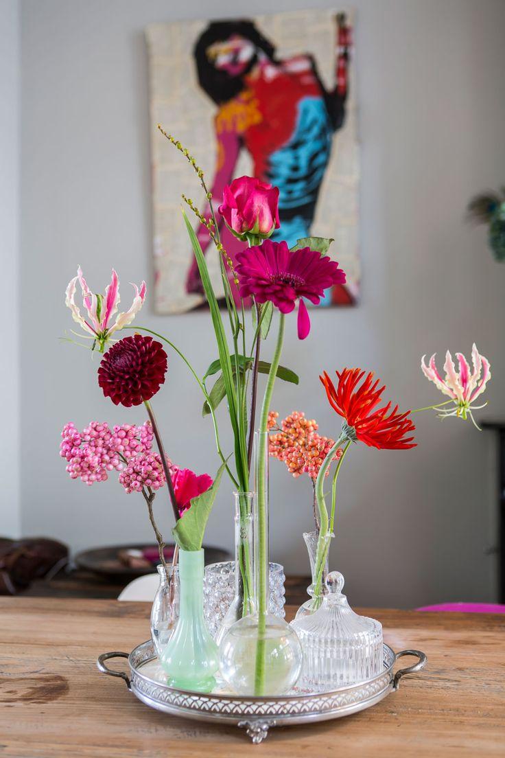 Diversity of flower on a tray in romantic bottles