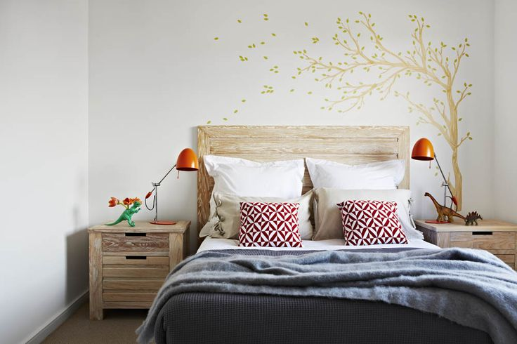 arkee projects for orbit homes.  Designs for Living Furniture and styling.  Aspire Home.  Chldrens bedroom with tree decale and graphic knit cushions