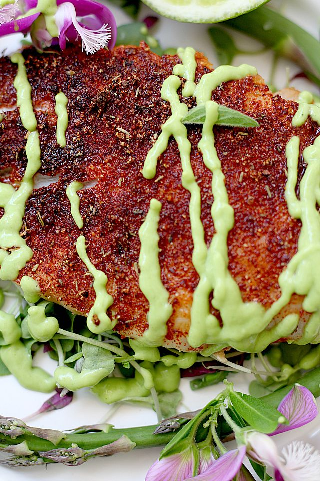 Tender white fish baked in the best blackened seasoning recipe and dressed in a delicious avocado fish taco sauce! This blackened rockfish recipe will rock your world! A seafood recipe perfectly paired over vegetables or in fish tacos.   Delightful Mom Food