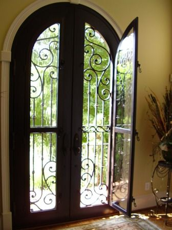 Want a metal arched door with built in glass and then a solid metal or aluminum or steel hinged door that can cover the glass part for privacy