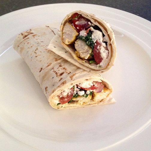 Baked moroccan chicken breast with sautéed red onion, wilted spinach & garlic topped with cherry toms & feta cheese wrapped tightly in a Gerry's Wonder Wraps - many thanks for sharing the recipe Facebooker @FlabULess NZ!