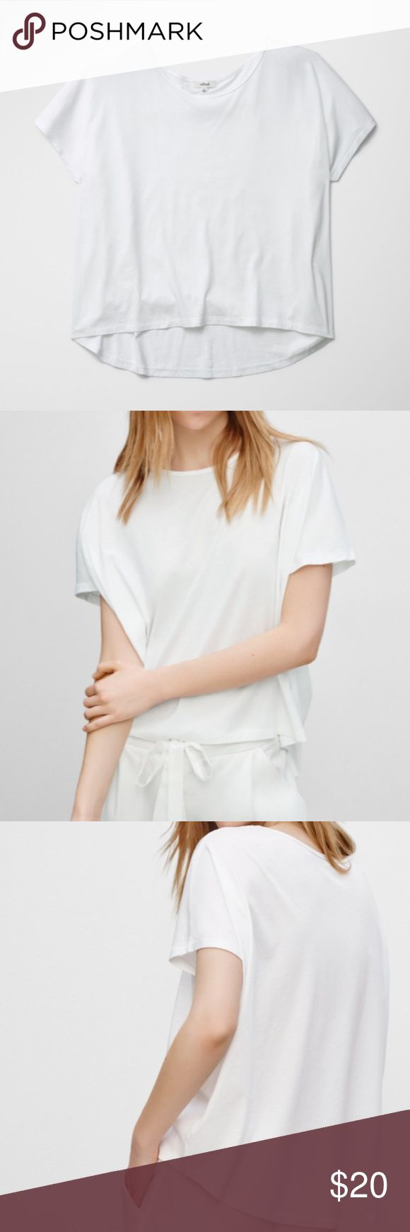 Aritzia Wilfred Berlioz T-Shirt This crisp, shite shirt is made with a nice Pima cotton blend. Also has a wide boatneck with loose sleeves (relaxed fit). Subtly hangs lower in the backs. Materials: 60% Pima cotton and 40% micromodal. Size XXS and never worn ~~ HAPPY POSHING :-) Aritzia Tops Tees - Short Sleeve