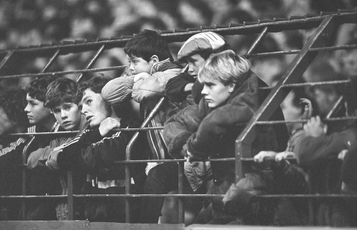 October 3 1984: Young Liverpool fans watch on at Anfield as their team smash four goals past Lech Poznan in the European Cup. Photo: Steve Hale