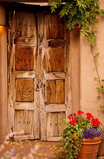 Rustic doors on Canyon Road, Santa Fe, NM. Road lined with art galleries.