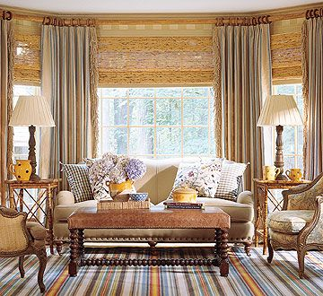 Layered window treatment to my bay windows, but in different fabrics