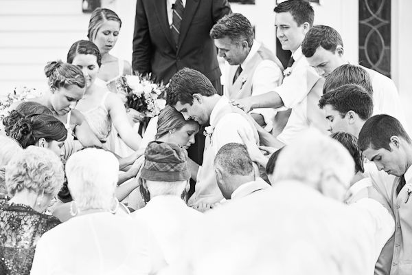 Have your family and friends pray for you after you the marriage ceremony - don't forget to get a beautiful shot of it! #wedding #traditional #christian