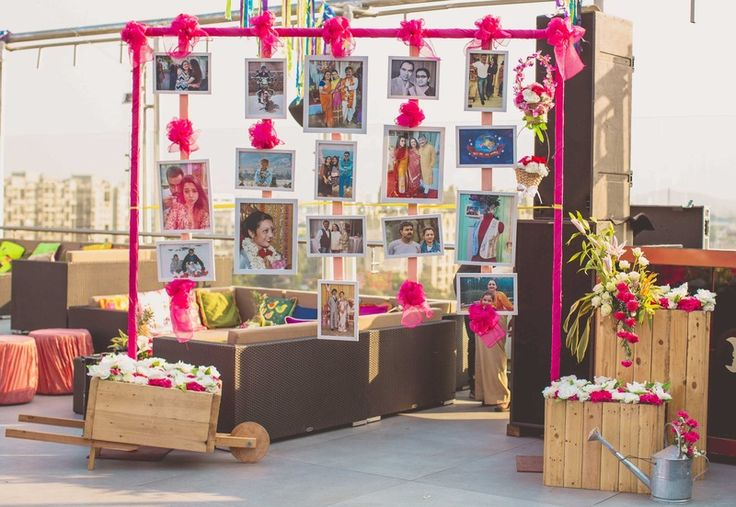 Mela themed mehendi ceremony with emotional photo booth setup and flower decoration. | weddingz.in | India's Largest Wedding Company | Wedding Venues, Vendors and Inspiration | Indian Wedding Mehendi Decoration Photobooth ideas |