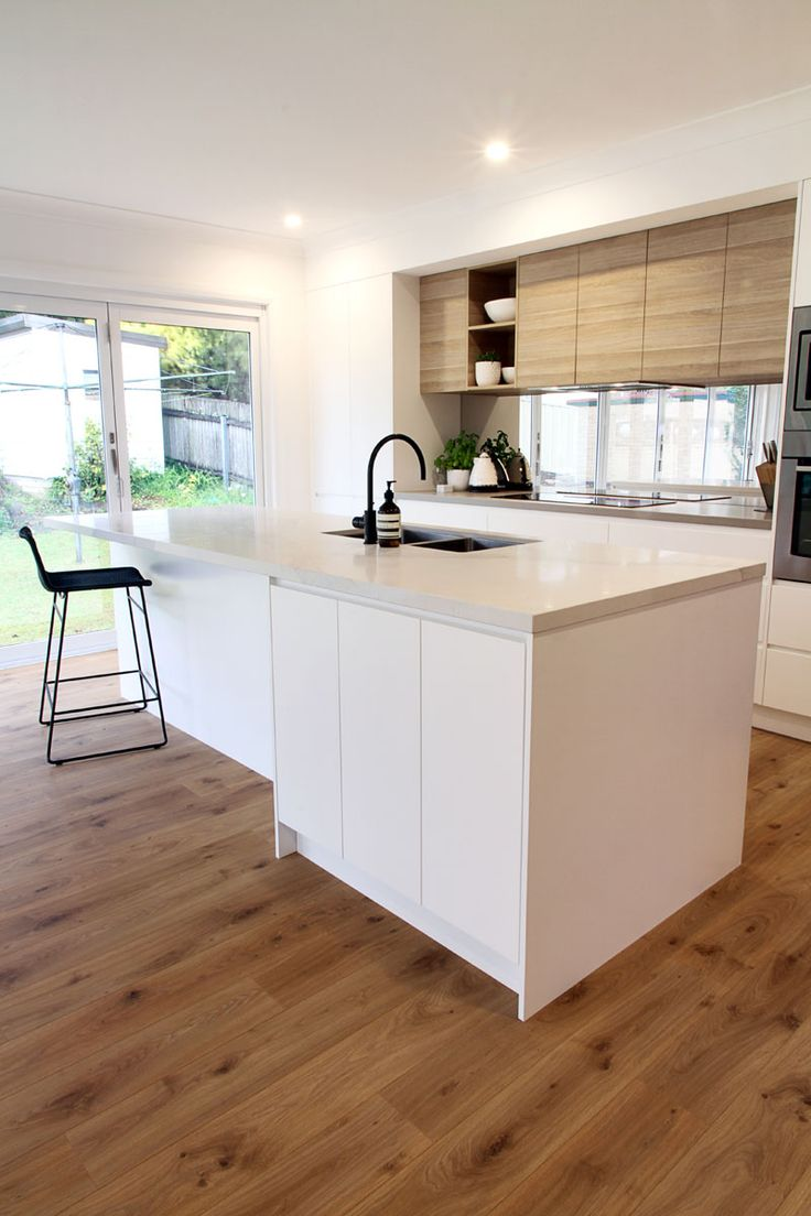 polytec doors in Natural Oak Ravine and Caesarstone benchtop Calacatta Nuvo. http://www.polytec.com.au/colour/natural-oak/